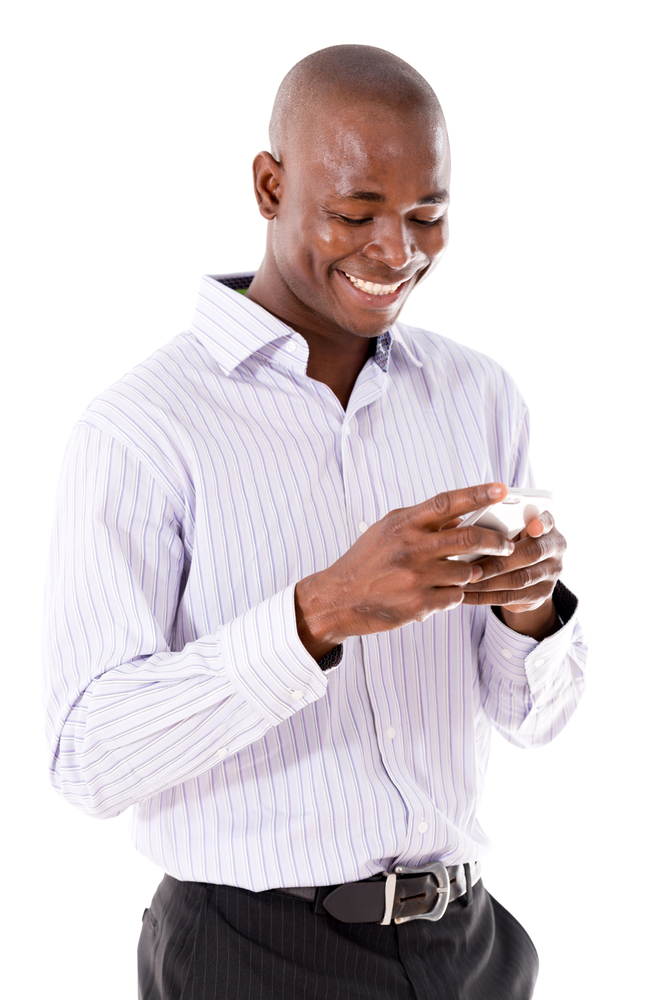Business man texting on his mobile phone  - isolated over a white background